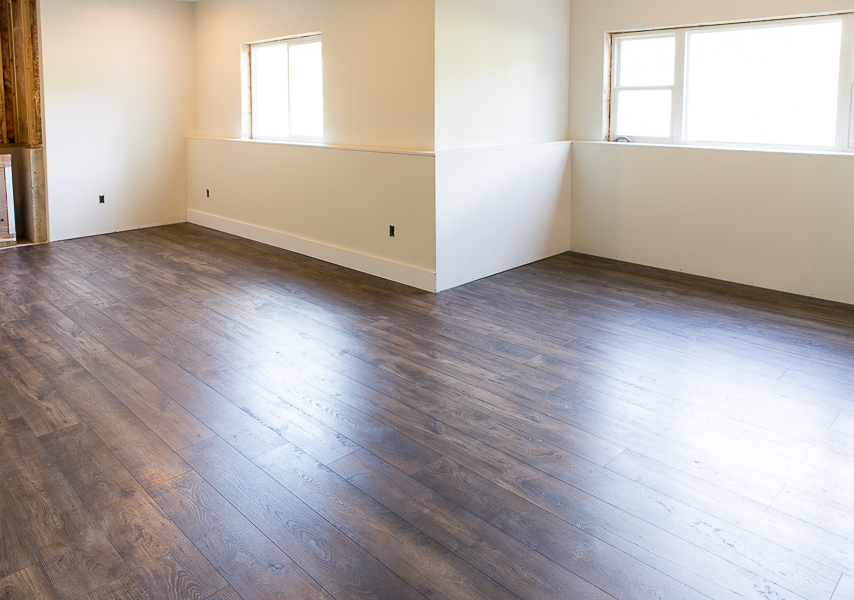 neutral basement dark flooring