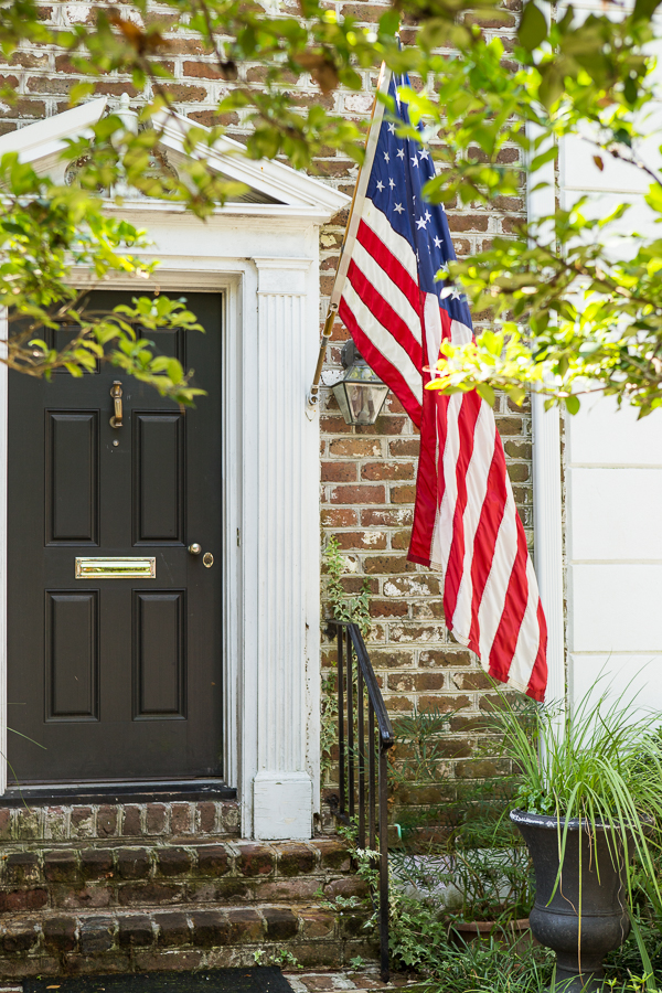 Traditional Charleston home with flag