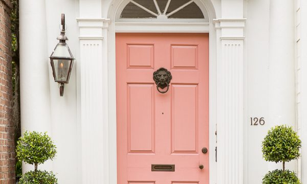 Iconic white house with pink door in Charleston