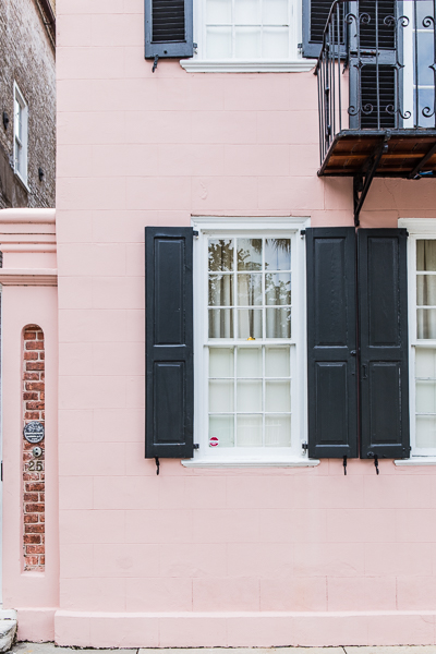 pink house with black shutters