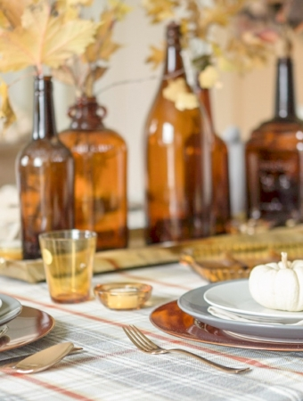 fall table with amber bottles